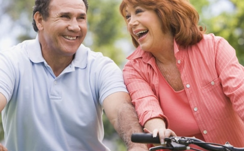 lifestyle image of man and woman riding a bike