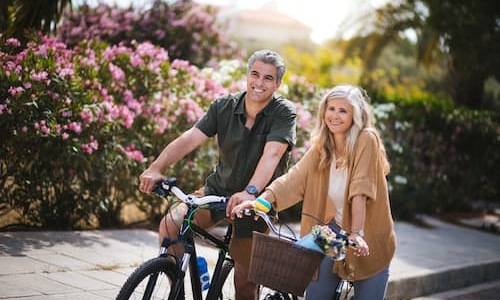 lifestyle image of a couple riding bicycles outside